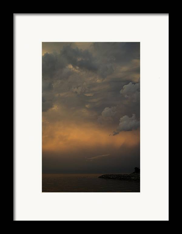 Cloud Framed Print featuring the photograph Moody Storm Sky Over Lake Ontario In Toronto by Georgia Mizuleva