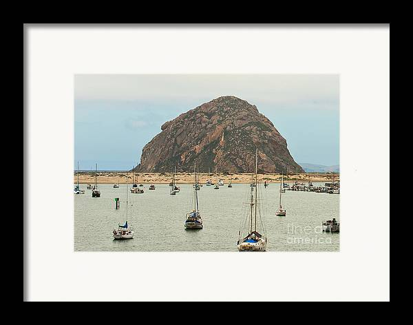 Morro Bay Ca Framed Print featuring the photograph Morro Bay Rock At Dawn by Artist and Photographer Laura Wrede