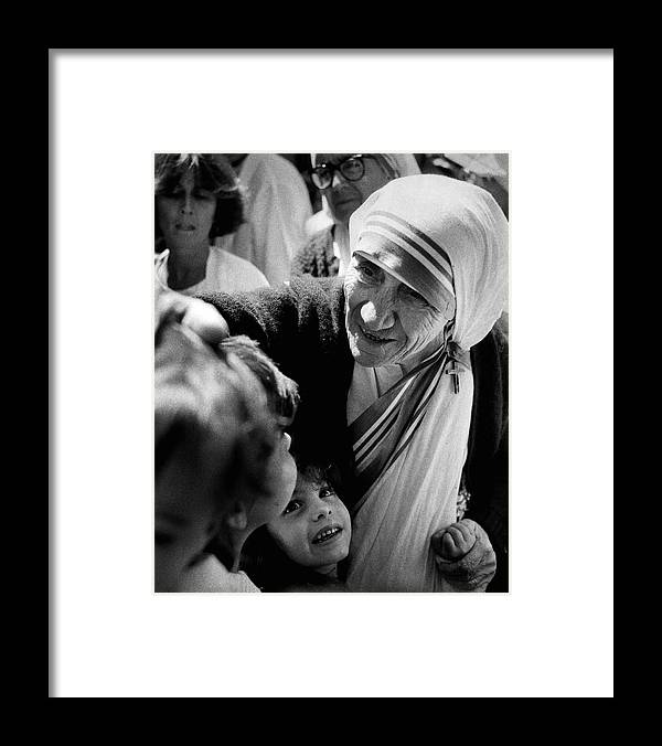 Classic Framed Print featuring the photograph Mother Teresa With Children by Retro Images Archive