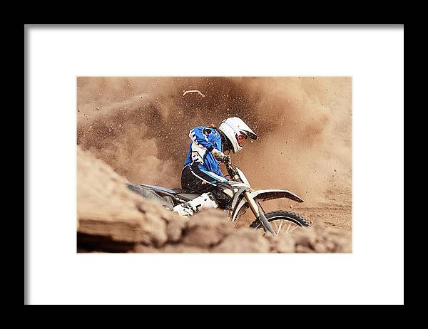Crash Helmet Framed Print featuring the photograph Motocross Biker Taking A Turn In The by Daniel Milchev