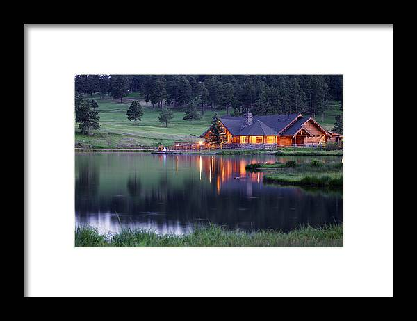 Water's Edge Framed Print featuring the photograph Mountain Lodge Reflecting In Lake At by Beklaus