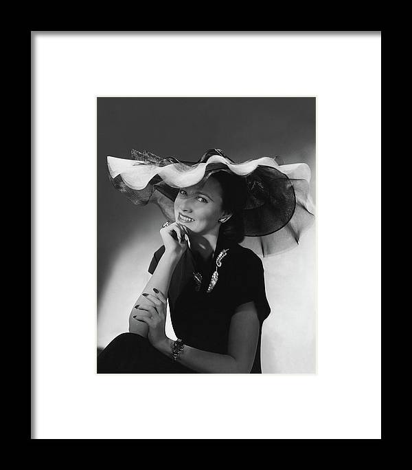 e842fed4154 Mrs. Willis Hunt Wearing A Lilly Dache Hat Framed Print by Horst P. Horst