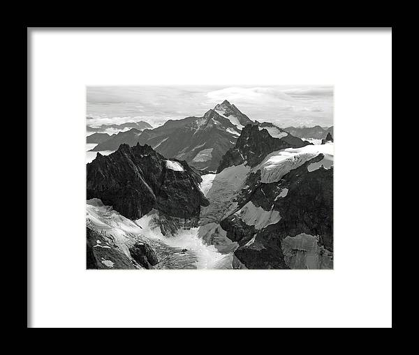 Mt. Titlis Framed Print featuring the photograph Mt. Titlis by Russell Todd