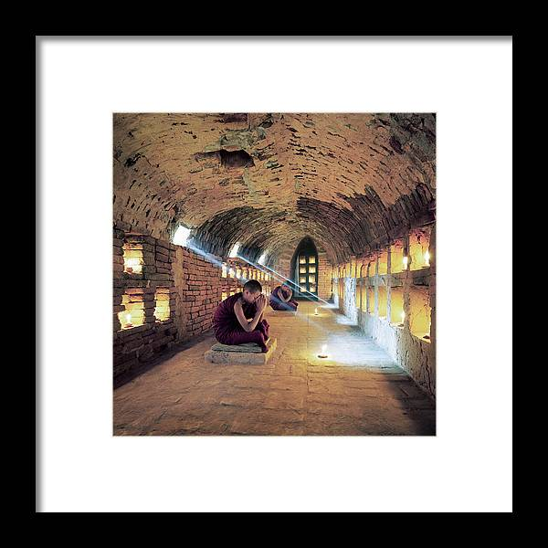 Arch Framed Print featuring the photograph Myanmar, Buddhist Monks Inside by Martin Puddy