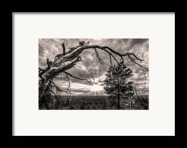 Clouds Framed Print featuring the photograph Natures Arch by Debra and Dave Vanderlaan