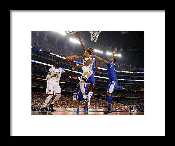 Connecticut Huskies Framed Print featuring the photograph Ncaa Mens Final Four - Championship by Jamie Squire