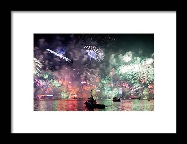 Firework Display Framed Print featuring the photograph New Year Fireworks Hong Kong Asia by Steffen Schnur