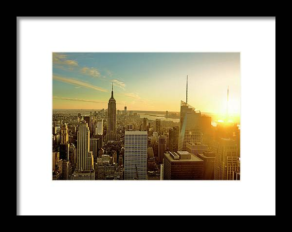 Downtown District Framed Print featuring the photograph New York City At Sunset by Aluxum