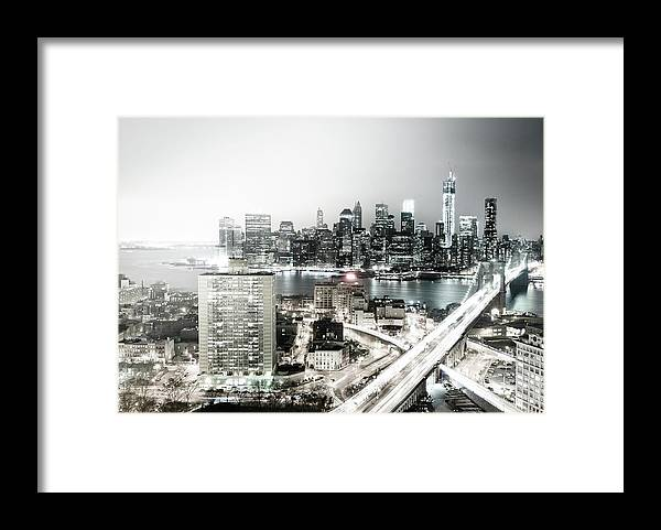 Lower Manhattan Framed Print featuring the photograph New York City Skyline At Night by Mundusimages