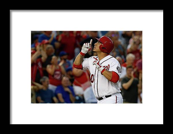 People Framed Print featuring the photograph New York Mets V Washington Nationals by Rob Carr