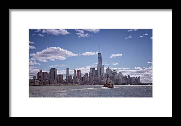 Joan Carroll Framed Print featuring the photograph New York Skyline And Boat by Joan Carroll