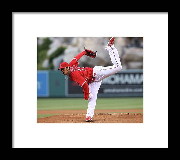 American League Baseball Framed Print featuring the photograph New York Yankees V Los Angeles Angels by Stephen Dunn
