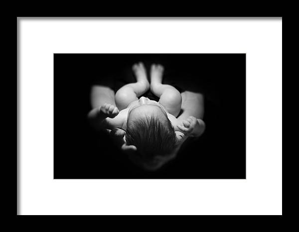 Baby Framed Print featuring the pyrography Newborn Baby Sleeping In Father's Hands by Pavlo Kolotenko