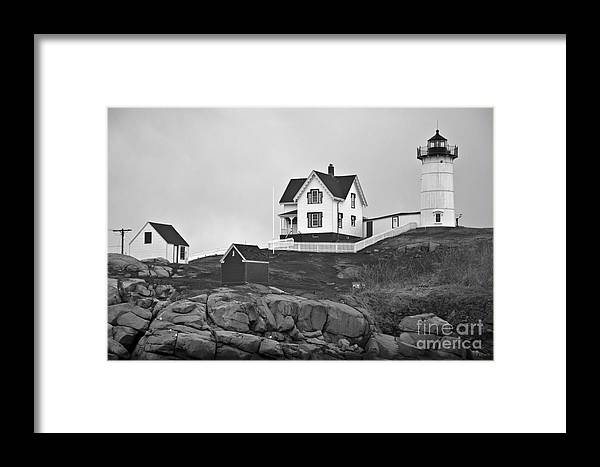 Nubble Lighthouse Framed Print featuring the photograph Nubble Lighthouse Cape Neddick Maine Black And White by Glenn Gordon