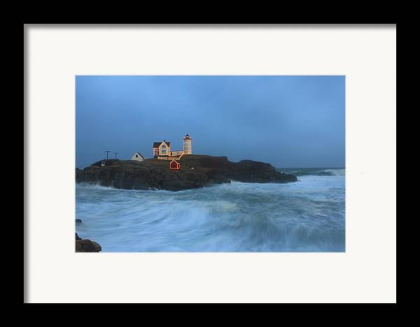 Maine Lighthouse Framed Print featuring the photograph Nubble Lighthouse High Surf And Holiday Lights by John Burk