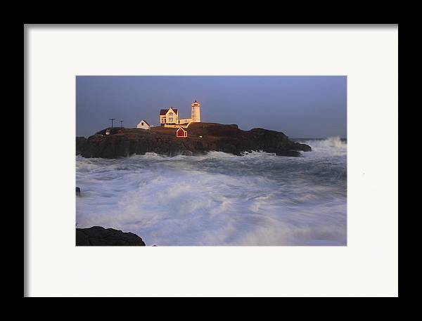 Maine Framed Print featuring the photograph Nubble Lighthouse Holiday Lights And High Surf by John Burk