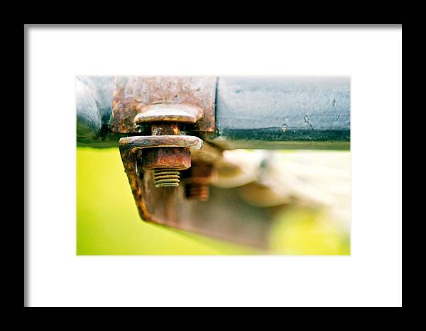 Bokeh Framed Print featuring the photograph Nuts And Bolts by Michael Tzacostas