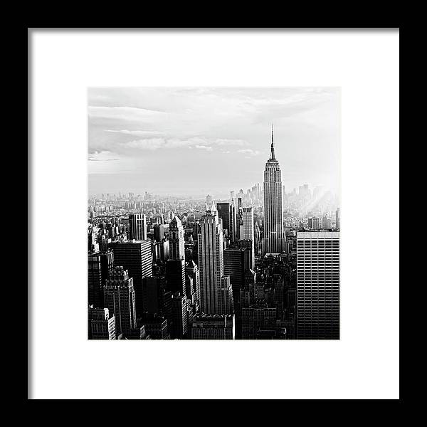 Lower Manhattan Framed Print featuring the photograph Nyc Skyline.black And White by Lisa-blue