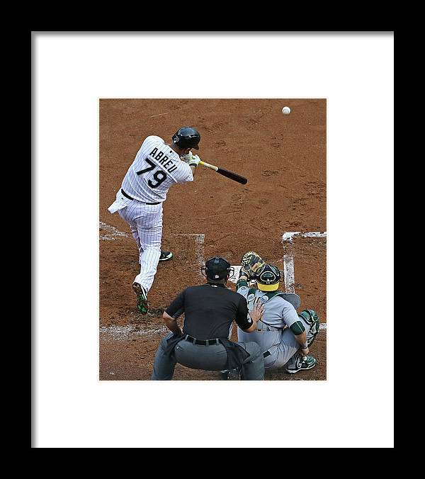 American League Baseball Framed Print featuring the photograph Oakland Athletics V Chicago White Sox by Jonathan Daniel