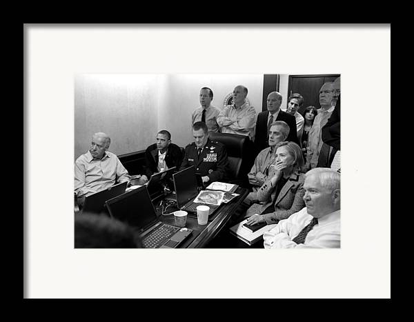 Bin Laden Raid Framed Print featuring the photograph Obama In White House Situation Room by War Is Hell Store