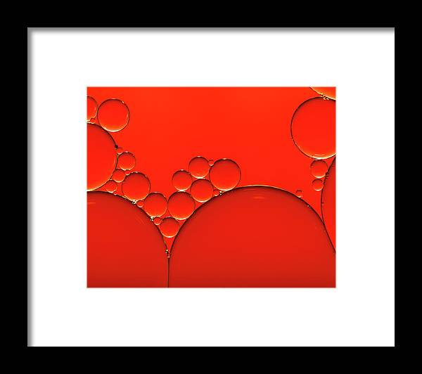 Research Framed Print featuring the photograph Oil And Water Drops Background by Assalve