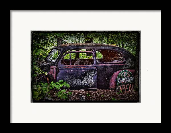 Old Car Framed Print featuring the photograph Old Abandoned Car In The Woods by Paul Freidlund