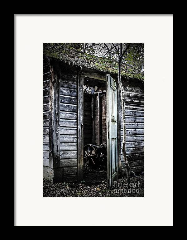 Sinister Framed Print featuring the photograph Old Abandoned Well House With Door Ajar by Edward Fielding