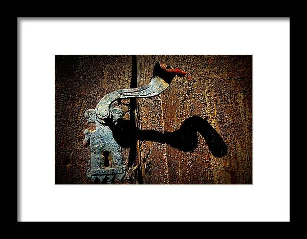 Old Door Handle Framed Print featuring the photograph Old Door Handle by Aarlangdi Art And Photography