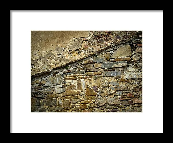 Weathered Framed Print featuring the photograph Old Eroded Stone Wall by Jozef Jankola