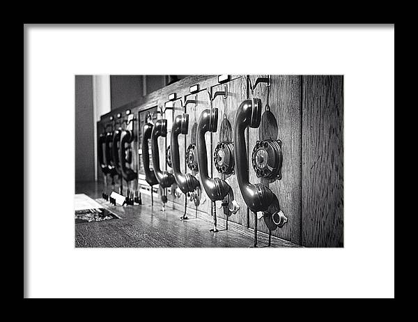 In A Row Framed Print featuring the photograph Old-fashioned Wooden Telephone by Anja Heid / Eyeem