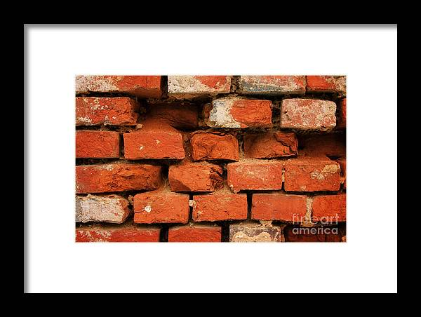 Old Red Brick Wall Framed Print featuring the photograph Old Red Brick Wall by Jolanta Meskauskiene