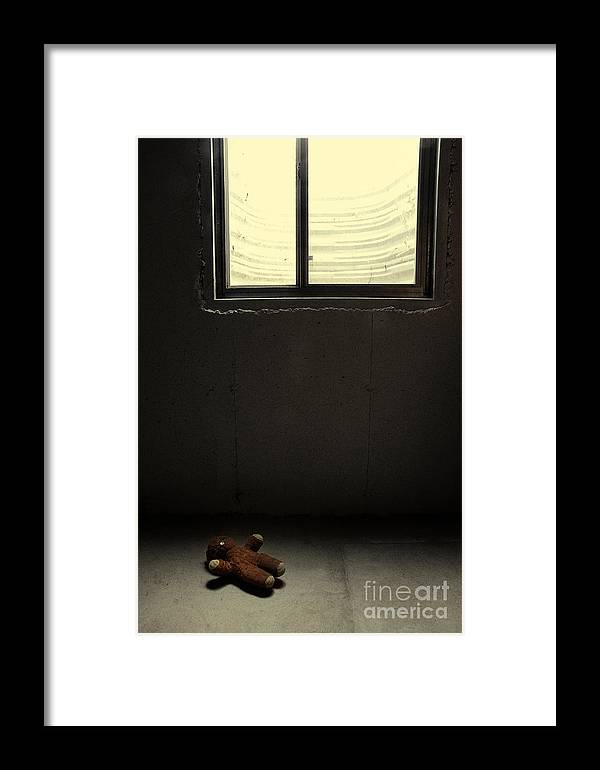 Child Framed Print featuring the photograph Old Teddy Bear In Basement by Birgit Tyrrell
