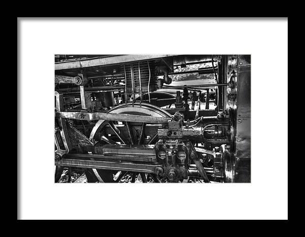 Old Train Wheel Framed Print featuring the photograph Old Train Wheel by Dewa Wirabuwana