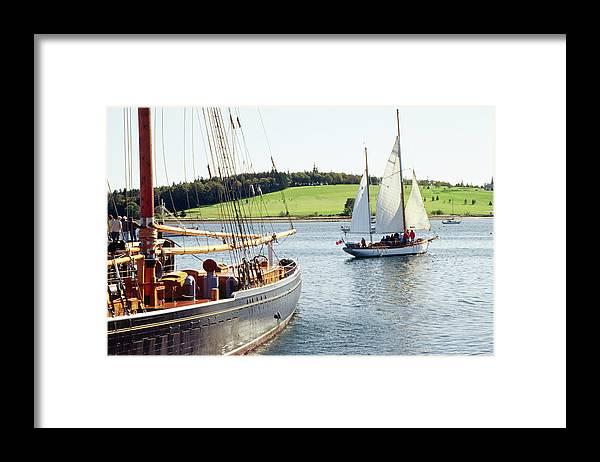 Old Wooden Sailboats Near Shore Framed Print