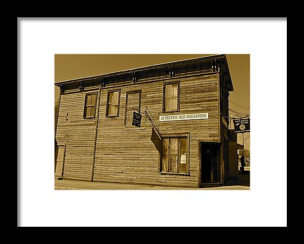 Sepia Framed Print featuring the photograph Oldest Drug Store 2 by Denise Mazzocco