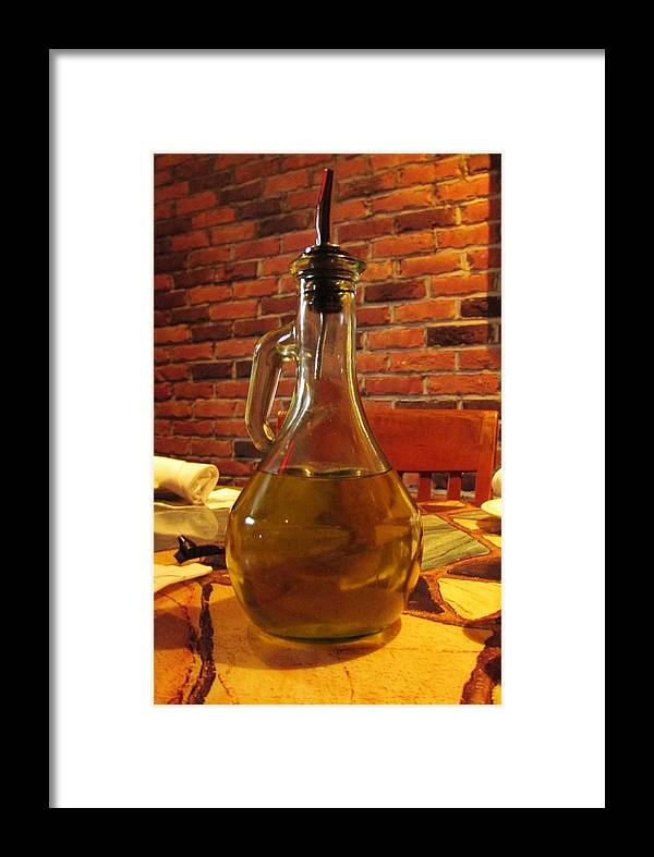 Olives Framed Print featuring the photograph Olive Oil On Table by Cynthia Guinn
