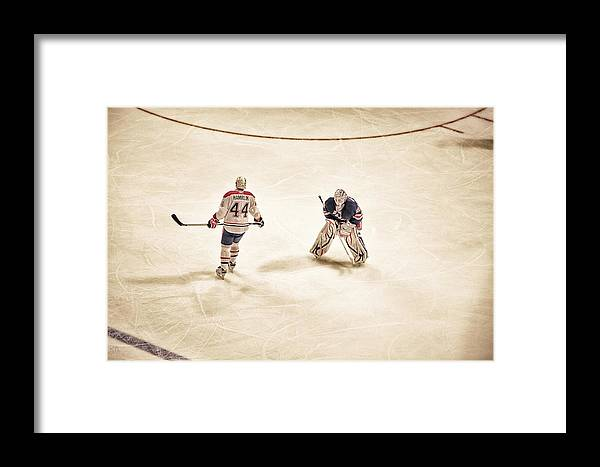 Hockey Framed Print featuring the photograph Opponents by Karol Livote