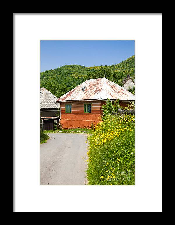 Rosia Montana Framed Print featuring the photograph Orange House In A Romanian Village by Gabriela Insuratelu