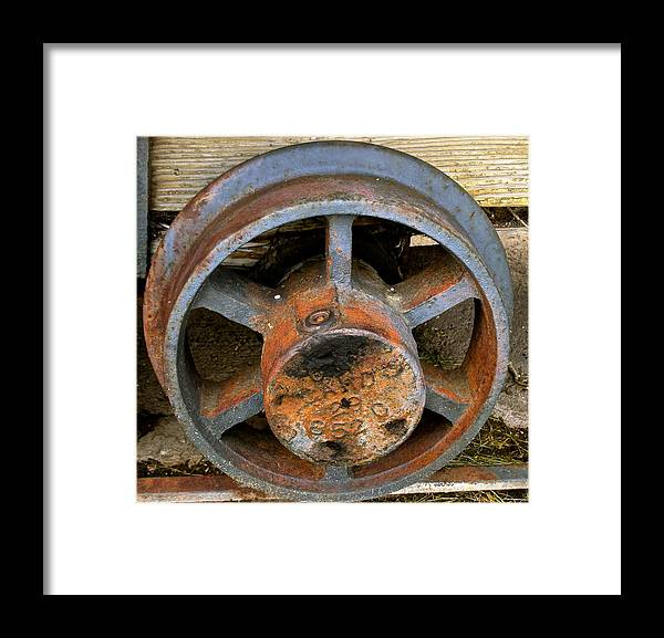 Ore Framed Print featuring the photograph Ore Cart Wheel by Jeff Gater