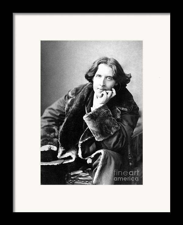1900; Writer; Seated; Fur-trimmed Coat; Author; Oscar Wilde Framed Print featuring the photograph Oscar Wilde In His Favourite Coat 1882 by Napoleon Sarony