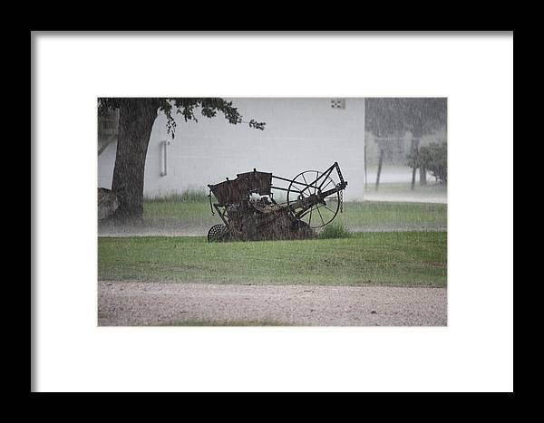 Downpour Framed Print featuring the photograph Out In The Rain by Jeff Tuten