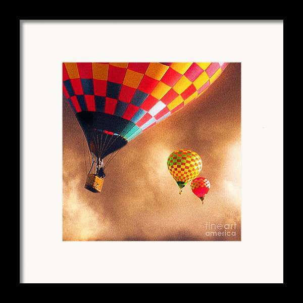 Hot Air Balloons Framed Print featuring the painting Out Of The Storm by Artist and Photographer Laura Wrede