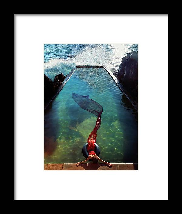 Human Arm Framed Print featuring the photograph Pacific Islander Woman In Mermaid by Colin Anderson Productions Pty Ltd