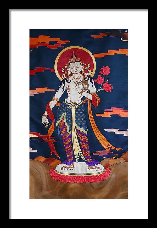 Padmapani. Thanka Framed Print featuring the tapestry - textile Padmapani by Leslie Rinchen-Wongmo