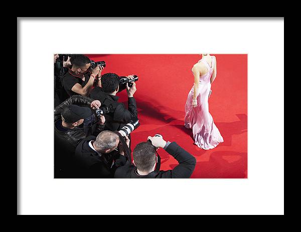 People Framed Print featuring the photograph Paparazzi taking pictures of celebrity on red carpet by Robert Daly