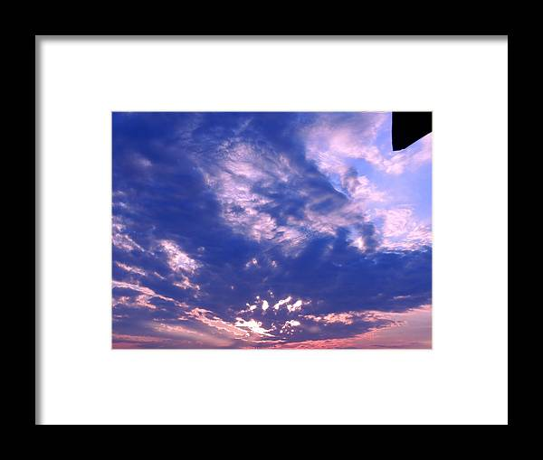 Clouds Framed Print featuring the photograph Passing Clouds by Nancy Wagener