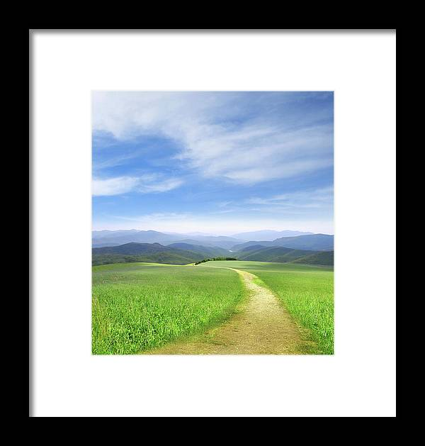 Tranquility Framed Print featuring the digital art Path Through Field Leading To Distant by Ryan Etter