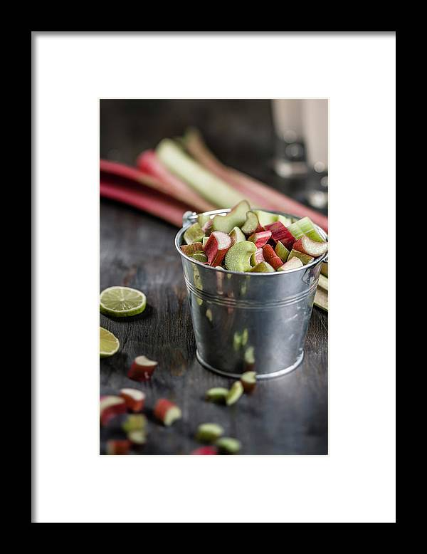 Bucket Framed Print featuring the photograph Pieces Of Rhubarb In Metal Bucket And by Westend61