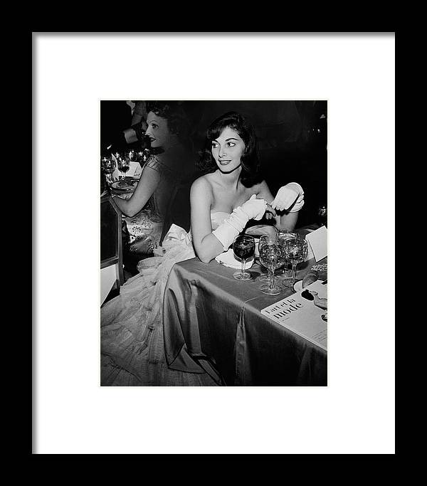 Party Framed Print featuring the photograph Pier Agnelli Wearing An Evening Gown At A Ball by Nick De Morgoli