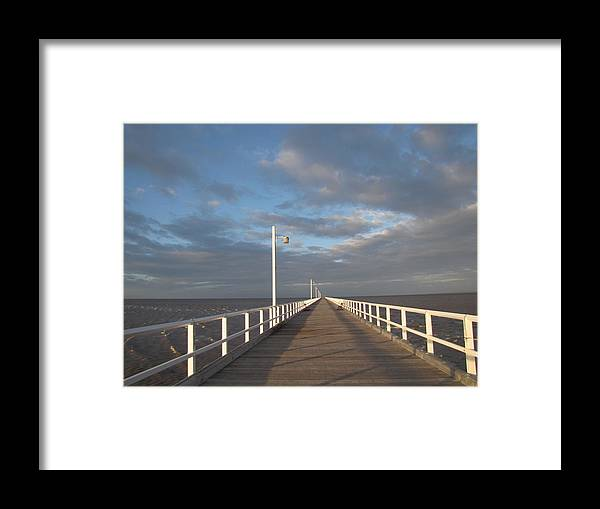 Pier Framed Print featuring the photograph Pier And Shadows by Elizabeth Hardie